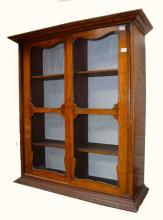 A SMALL DEAL BOOKCASE, with two sliding doors, 30'