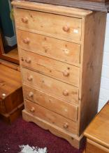 A SIX DRAWER PINE CHEST, 23'' (59cms). (1)