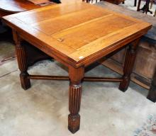 AN OAK DRAW-LEAF TABLE,  on reeded legs, 36'' (92c