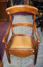 AN OLD BEECH FRAMED ARM CHAIR COMMODE. (1)