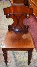 A WILLIAM IV PERIOD MAHOGANY HALL CHAIR,  with dou