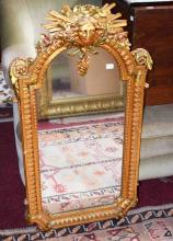 A MODERN GILT PIER MIRROR,  crested with a classic
