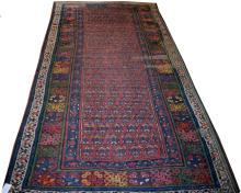 A SEMI-ANTIQUE PERSIAN RUG,  the centre panel with