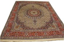 A LARGE PERSIAN MOUD RUG,  with central circular f