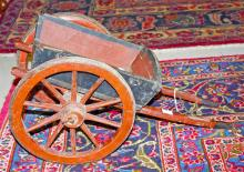 A WOODEN SCALE MODEL OF A HORSES CART,  with two s