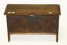 A MINIATURE PLANK-TOP COFFER CHEST, probably 18th