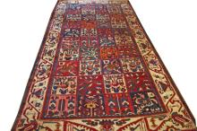 A PERSIAN BAKTIARI RUG,  with three rows of square