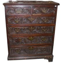 AN 18TH CENTURY OAK CHEST, with four long two shor