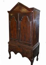 AN IRISH LATE 18TH CENTURY YEW WOOD CUPBOARD-ON-CH