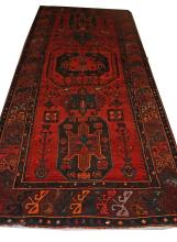 A RED GROUND PERSIAN HAMADAN LORI RUNNER,  with ce