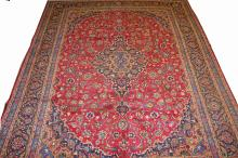 A PERSIAN KASHAN CARPET,  with dark blue, fawn and
