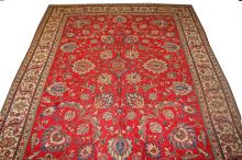 A FINE RED GROUND TABRIZ CARPET,  with all over fl