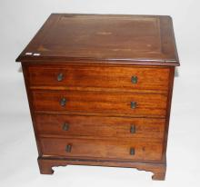 AN ATTRACTIVE INLAID MAHOGANY FOUR-DRAWER CHEST,