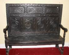 A CARVED OAK HIGH BACK BENCH,  18th century and la