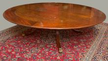 A LARGE CIRCULAR MAHOGANY DINING TABLE,  in the ma