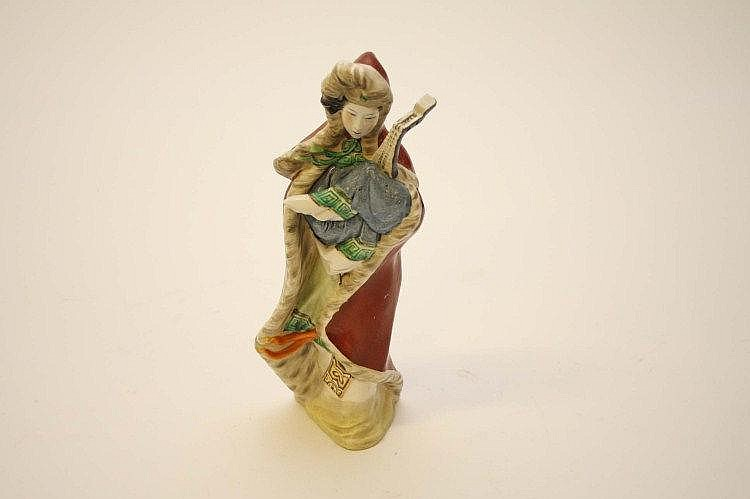 A CHINESE PORCELAIN FIGURE MODELLED AS A WOMAN
