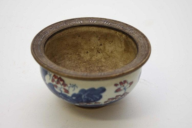 A CHINESE BLUE, WHITE AND RED POTTERY BOWL. 5.5in
