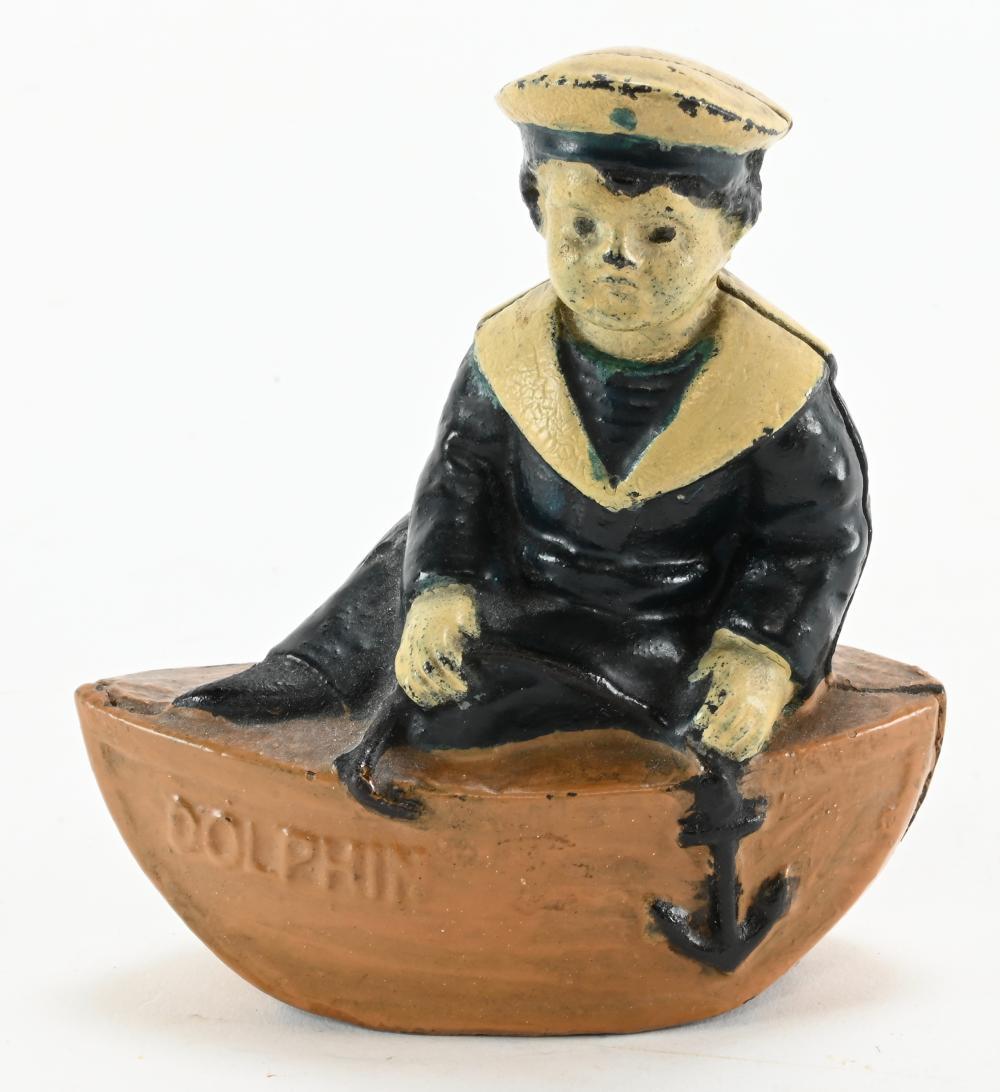 Vintage Cast Iron Dolphin Boy Bank