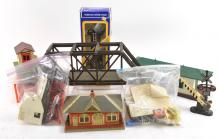 Group of toy train accessories