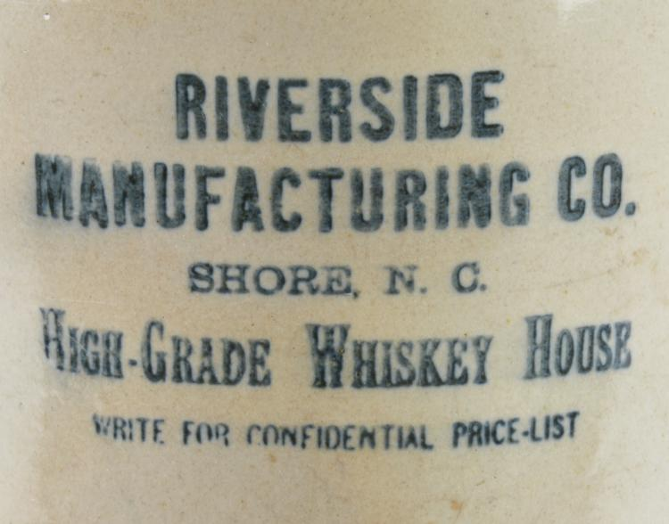 Lot 23: Riverside Manufacturing Whiskey Shore NC Jug