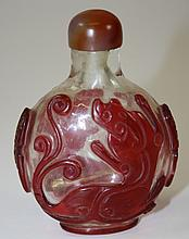 Oriental cameo glass snuff bottle w/ dragon motif,