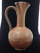 Rookwood redware flower and vine decorated ewer