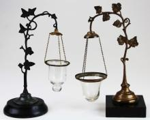 two early Victorian floating candle lamps