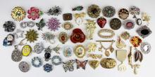 group of costume jewelry brooches and pins