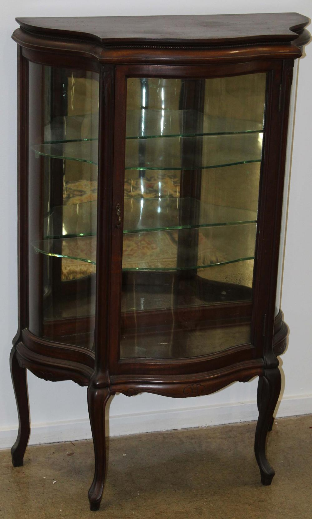 diminutive mahogany serpentine curio cabinet