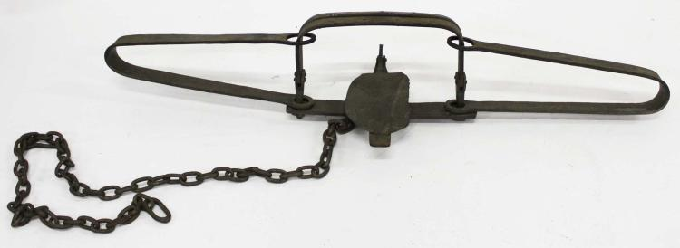 rare large old leg hold trap - 750×274
