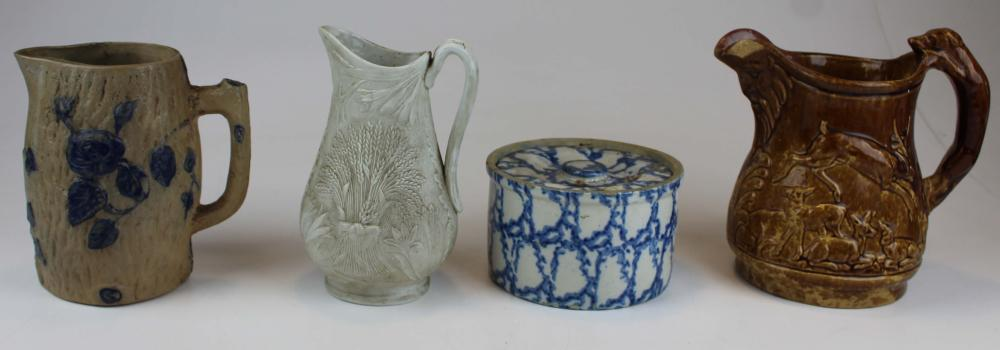 4 pcs. Parianware, Rockingham, Blue decorated Stoneware Pitchers, and a Blue decorated Butter Crock with Lid