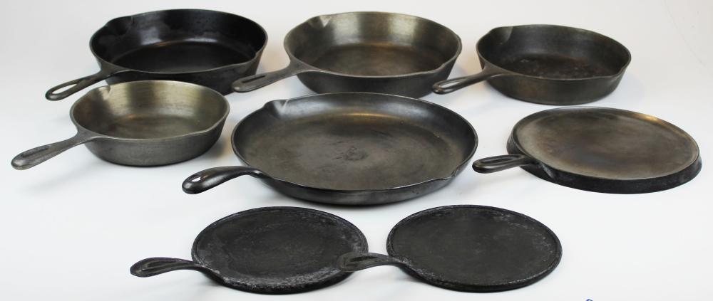 vintage cast iron frying pans including Erie