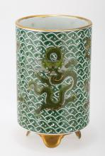 A GILT GREEN-GROUND PORCELAIN BRUSH HOLDER.THE BASE MARKED WITH YONG ZHENG YU ZHI BLUE FOUR-CHARACTER.C201. China.Possibly Qing dynasty or later, the sides depicting a roaring five-claw dragon. CONDITION: Good, no significant damage or repairs observed. C Property from a Private American New York city Collection. Measure: Height 6.75