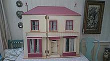 A wooden double-fronted doll's house and contents,