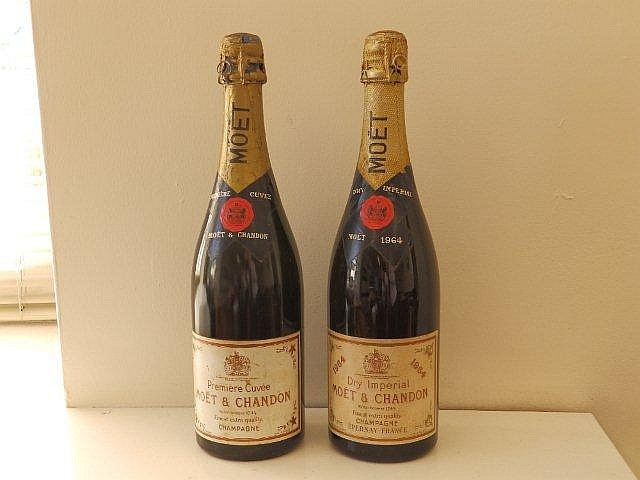 two bottles of moet et chandon champagne one dated 1964. Black Bedroom Furniture Sets. Home Design Ideas