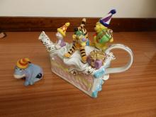 A Cardew limited edition Captain Pooh teapot, a limited edition Hutch dresser teapot, together with a large Winnie the Pooh Birthday Cake limited edition example. (3)