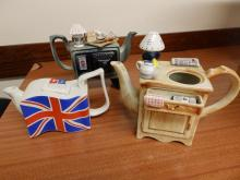 A South West Ceramics Tea for Two Tea Council Design teapot ? 1990, a Union Jack teapot and another missing its lid. (3)