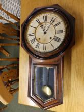 An Ansonia striking wall clock.