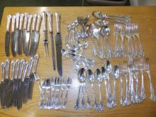 An eight piece setting of EP cutlery.