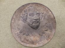 A heavy 19thC cast iron circular portrait plaque commemorating 'William Shakespeare', 21? diameter.
