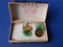 A pair of Chinese jade coloured hoop and yellow metal disc cufflinks in original 'Nan King' cardboard box.