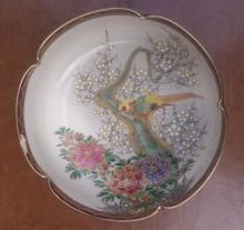 A small signed Japanese bowl decorated with a bird ? chipped.