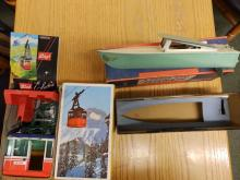 A Jetcraft model speed boat and a modern Lehman cable car. (2)