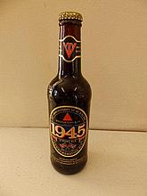 A bottle of 50th Anniversary VE & VJ Day Commemorative ale together with a