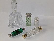 Two silver top cut glass scent bottles, two double-ended scent bottles and