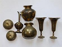 Four Indian brass vases, a pair of small bowls and a ewer. (7)