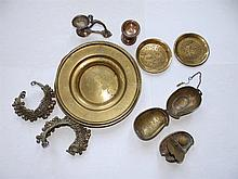 A brass pan-supan basket, two Indian bracelets, four other pieces and a Com