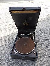 An HMV wind-up portable record player.