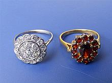A diamond cluster ring and a 9ct garnet ring. (2)