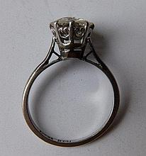 A diamond solitaire ring, the claw set old cut stone weighing approximately